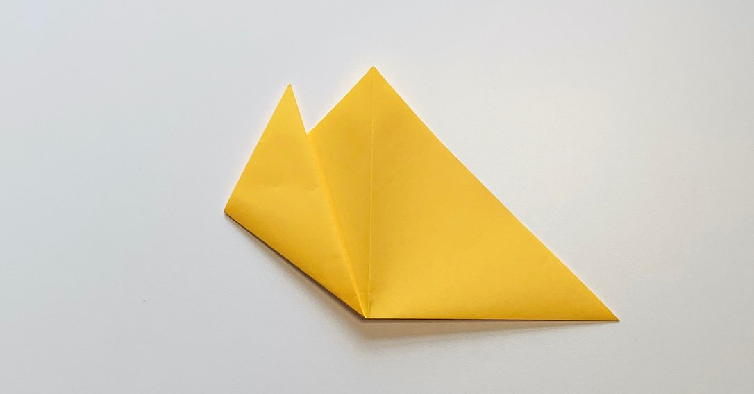 origami flower instructions fold the point of the triangle upwards once