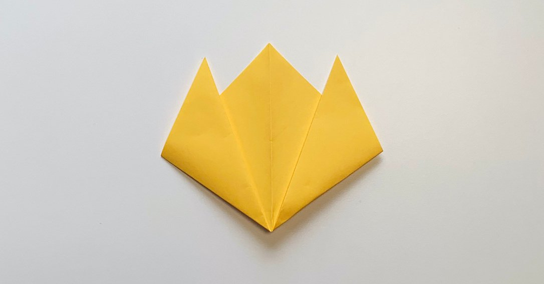 origami flower instructions fold the point of the triangle upwards twice
