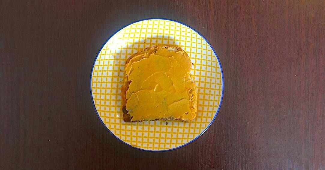 spread peanut butter on toast