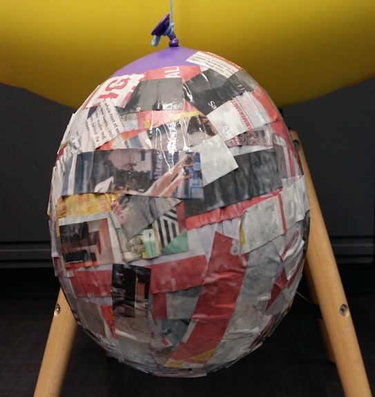 Cover balloon in newspaper and glue