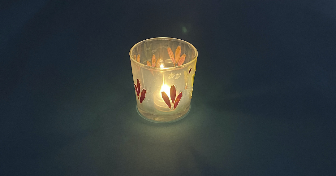 place an electric tealight into the flower press lantern