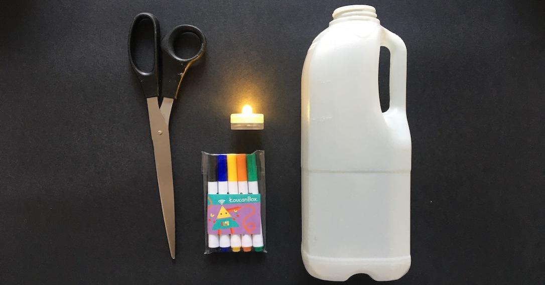 materials needed to make milk bottle ghosts