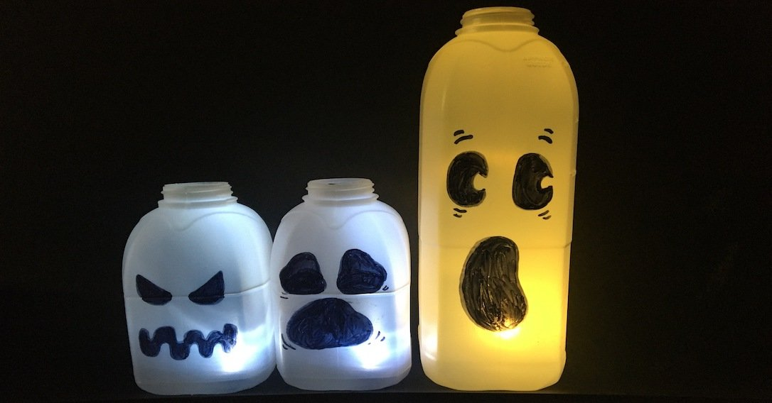 a group of milk bottle ghosts