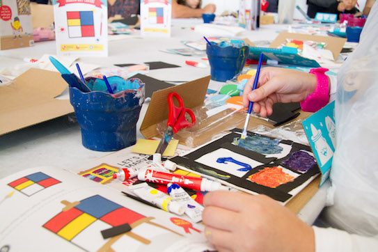 children painting Mondrian inspired art