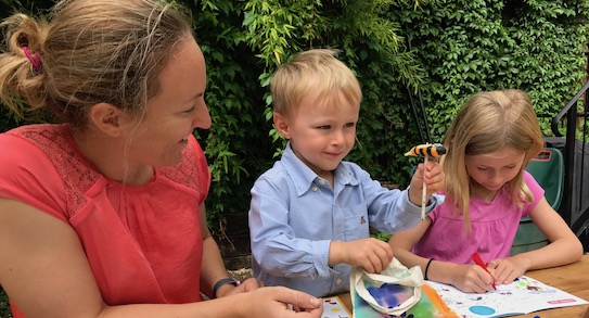 Mum doing crafts with children and supporting language development